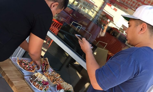Man taking a picture of DonerG Foods